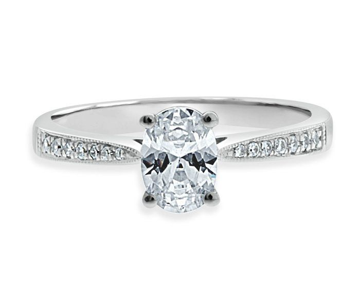 oval-cut-side-stone-diamond-engagement-ring-image-1